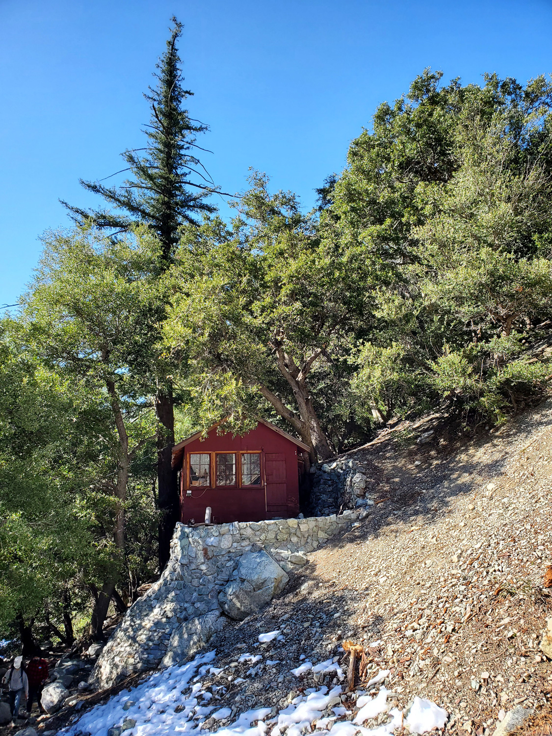 One of the red-walled cabins near the start of the Icehouse Canyon Trail
