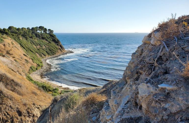 The sea sits in a lovely little inlet at the base of a canyon