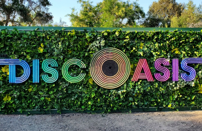 The brightly rainbow sign at the entrance of DiscOasis