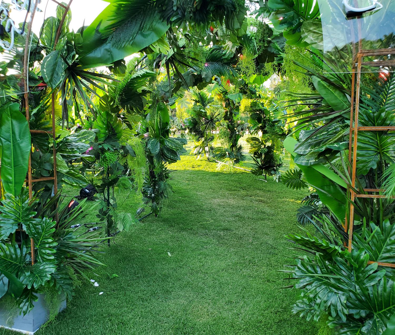 The plant-strewn hallway leading into the art walk